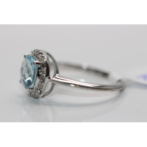 59 - ***£1735.00*** 9CT WHITE GOLD LADIES DIAMOND AND TOPAZ RING, DIAMOND WEIGHT- 0.10CT, COLOUR- D, CLAR...