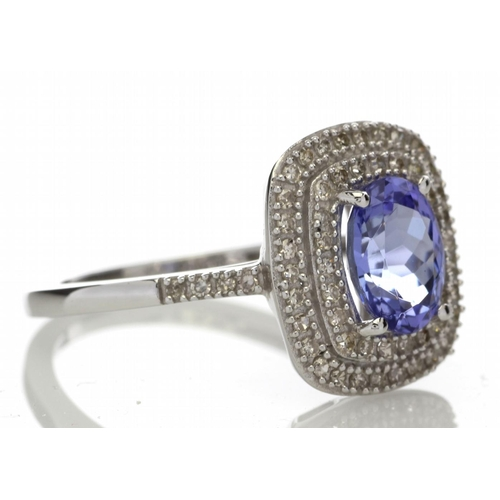 13 - Valued by GIE ?3,105.00 - 9ct Gold Oval Tanzanite And Diamond Cluster Ring 0.33 Carats - 6173001TZ, ...