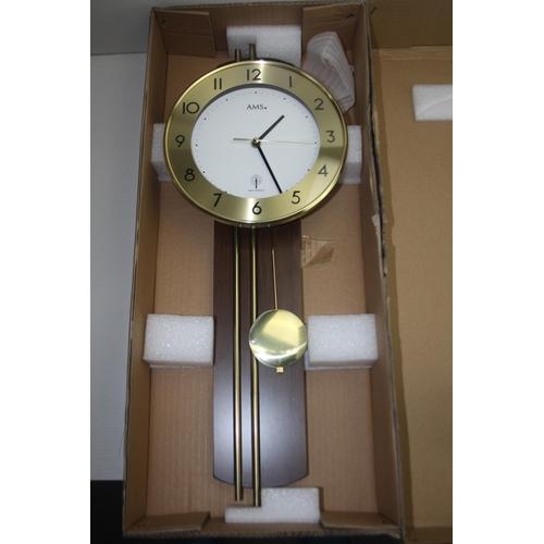 74 - GRADE U- BOXED FANCY DESIGN WALL HANGING CLOCK...