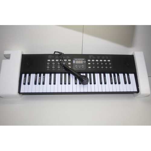 900 - GRADE U- BOXED AXMAN KEYBOARD WORK STATION WITH MICROPHONE MODEL: LP-5450 RRP-£40...