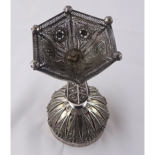 10 - A Kiddush cup, white metal having filigree applied decoration, openwork foot and script rim.  One ba...