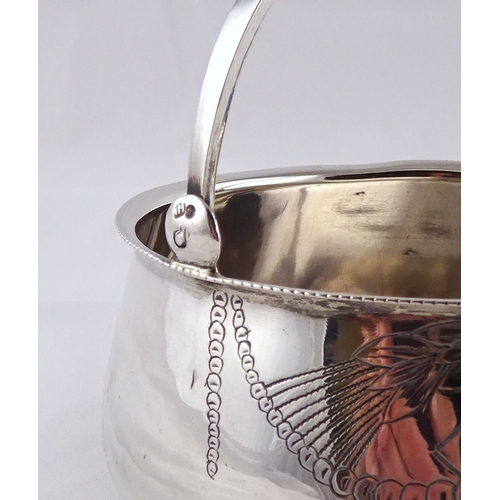 11 - A Russian white metal swing handle bowl on three ball feet, 98mm diameter; a Russian white metal fid...