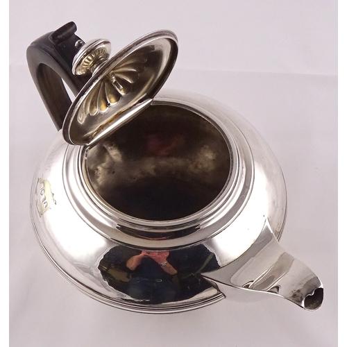 13 - A George IV silver tea pot having rosewood handle, London 1822, sponsors mark rubbed.  670gr gross /...
