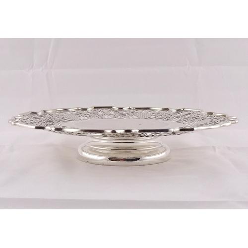 17 - A silver tazza having pierced border incorporating vine and grape design, Sheffield 1943.  283mm dia...