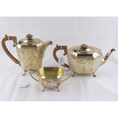 26 - A silver part tea set, comprising teapot, water jug and sugar basin, Sheffield 1938 / 39.  Teapot 28...