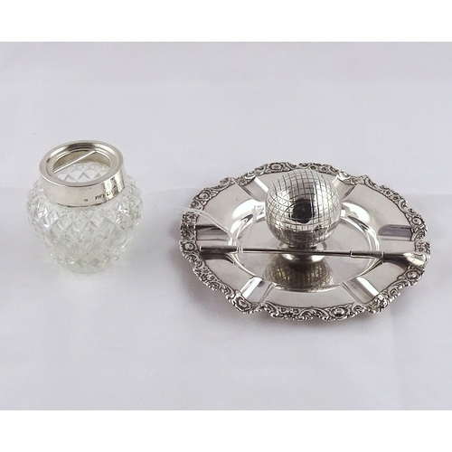 29 - A golfing interest ashtray incorporating ball and club motif decoration, white metal marked