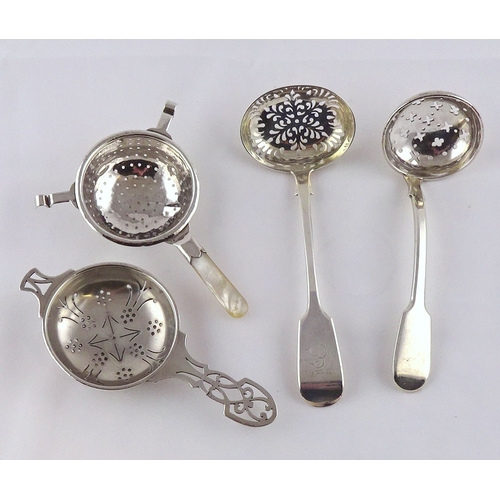 35 - Two Victorian silver fiddle pattern sifter spoons; two silver tea strainers.  145gr gross / silver &...