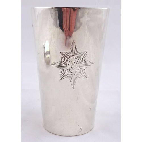 37 - A Victorian silver beaker engraved with the crest of the Irish guards, London 1875, 104mm tall; a si...