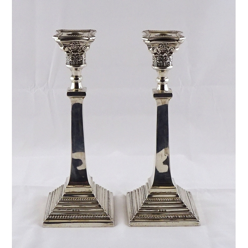 4 - A pair of squared-based hollow silver candlesticks, Birmingham 1947.  615gr / 265mm tall. (by instru...