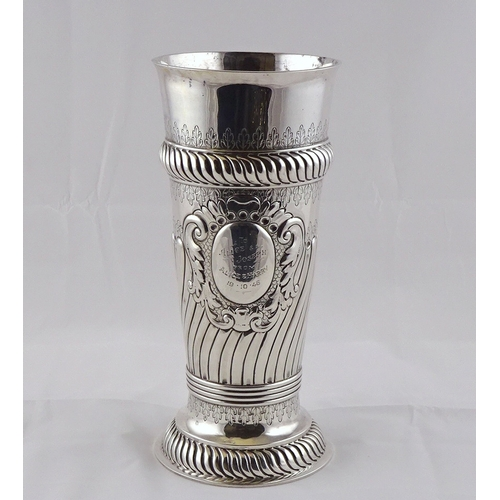 7 - A Victorian silver vase having raised decoration incorporating panel with presentation inscription d...