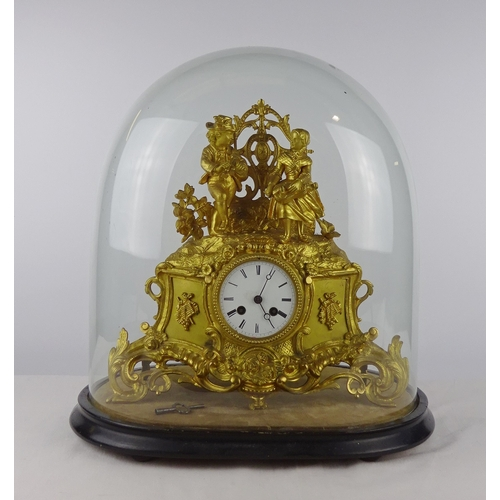 2 - A continental mantel clock in a gilt base metal figural case, approximately 35cm tall presented on a...