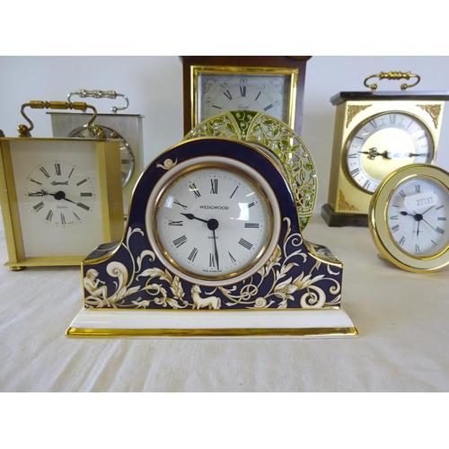 10 - A small Wedgwood Cornucopia quartz clock 16cm wide 11cm high together with 6 further quartz clocks.