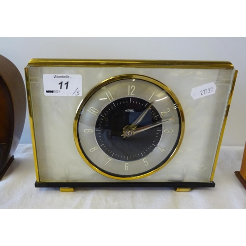 11 - A mid-century Metamec perspex 8 day mechanical mantle  clock 21cm wide 15cm high together with four ...