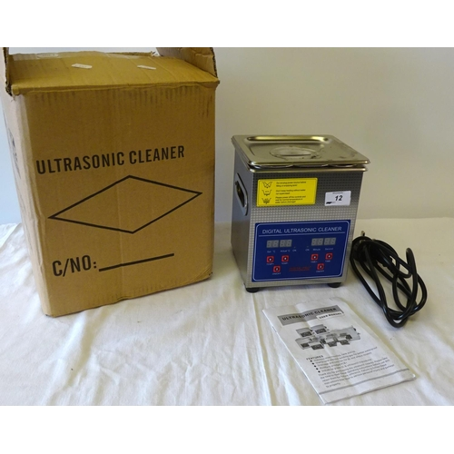 12 - An ultrasonic cleaner, boxed.