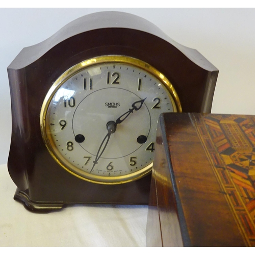 13 - A carved oak barometer together with a small barometer, an oak biscuit barrel, inlaid box (loose lid...
