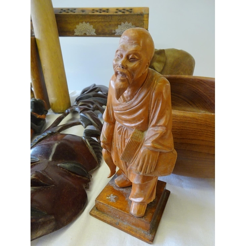 16 - A collection of wooden figures etc to include a pair of carved elephant bookends.