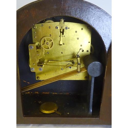 3 - An Edwardian inlaid mahogany mantel clock 48cm wide 26 cm high, missing crutch.