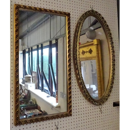 34 - A rectangular gilt framed mirror, 35cm x 66cm together with an oval mirror.