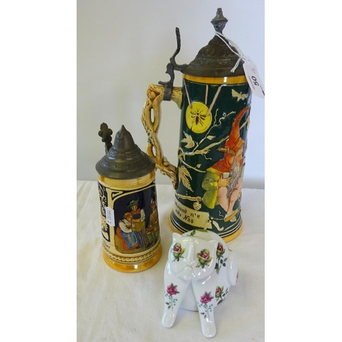 50 - A small Royal Dux cat 9cm high together with two German Steins. (3)