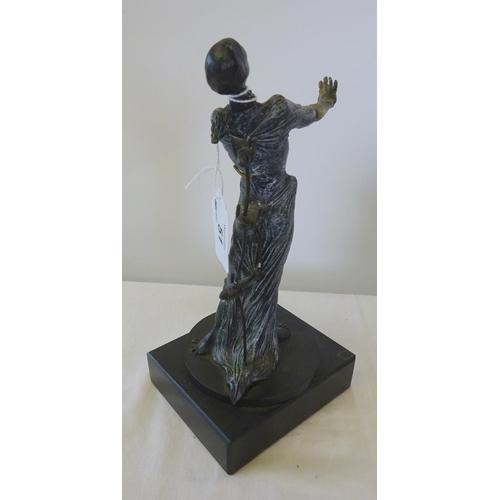 51 - A resin Dali sculpture 22cm tall.