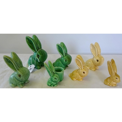 52 - Six Sylvac Rabbits plus another unsigned, 8-13cm tall, some crazing.