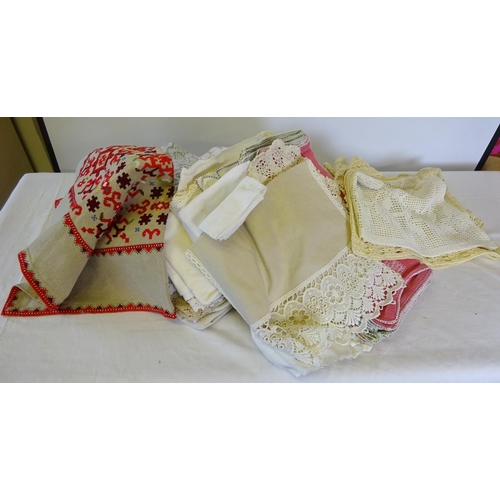 55 - Two boxes of various linens to include table cloths doilies etc. (2)