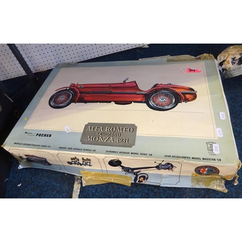 56 - An Alfa Romeo model racing kit car together with various board games.