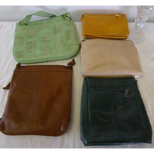 6 - A Yoshi handbag 23 cm wide 18cm high together with four further handbags (all used) and three glass ...