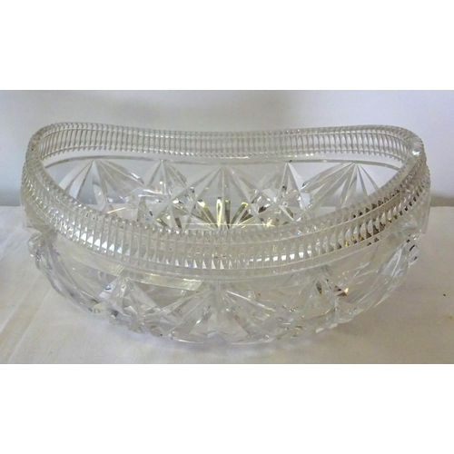7 - A large heavy cut glass fruit bowl 30cm wide 12cm high together with a cut glass vase (2 small chips...