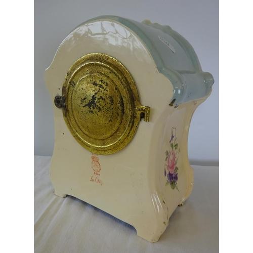 8 - A Royal Bonn floral ceramic striking mantle clock 26cm high 22cm wide.