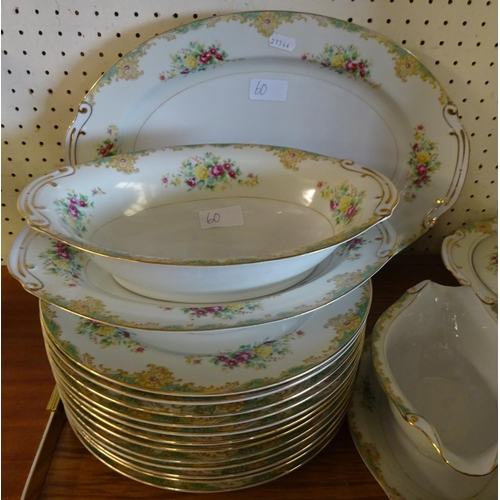 60 - A large floral dinner and tea service, chips to plates, a/f