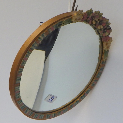 22 - A convex Barbola circular mirror 34cm diameter.