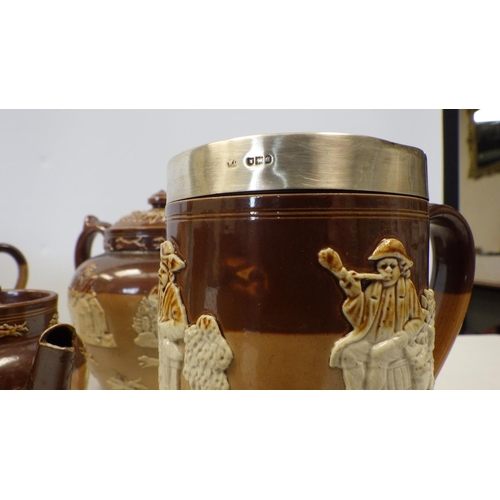 28 - A quantity of various Doulton moulded relief tankards etc together with Three Art Deco jugs etc af (...
