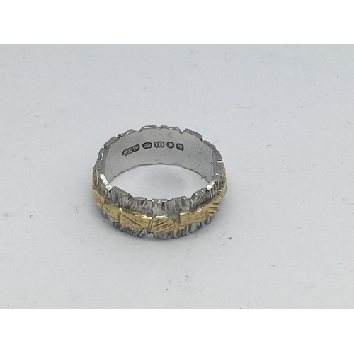 1 - An 18ct yellow and white gold band, 5.3g, (J)....