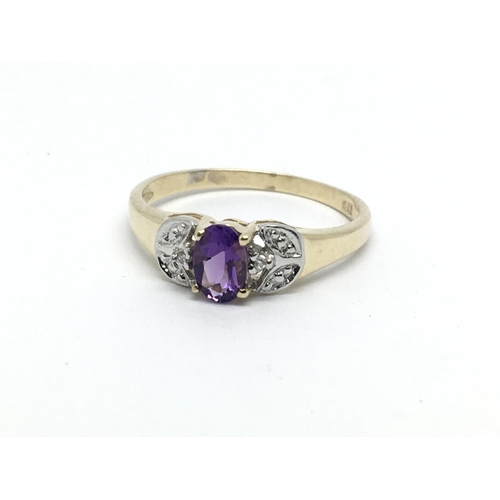 11 - A 9ct gold amethyst and small diamond ring, approx 1.6g and approx size N....