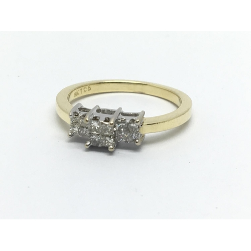 12 - An 18ct gold ring set with twelve princess cuts, approx 3.5g and approx size M....