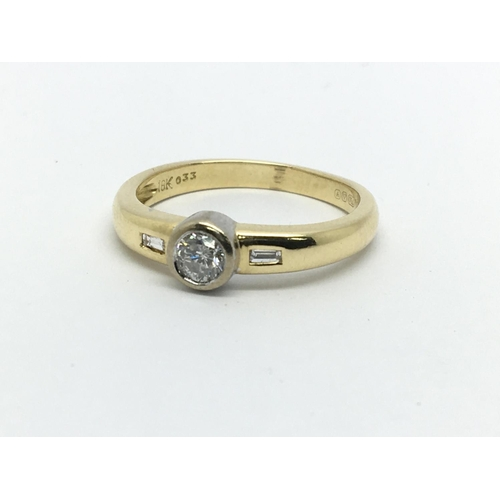 13 - An 18ct gold solitaire diamond ring with diamonds to the shoulders, approx.25ct, approx 4.3g and app...