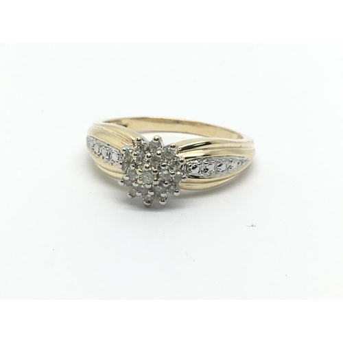 14 - A 9ct gold diamond cluster ring, approx 2.8g and approx size N....