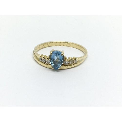 17 - A 9ct gold aquamarine and diamond ring, approx 3.2g and approx size Q-R....