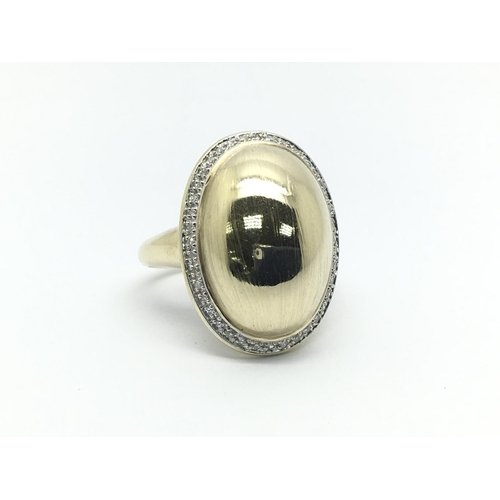 18 - A 9ct gold ring of oval design with a diamond surround, approx 5.2g and approx size P....