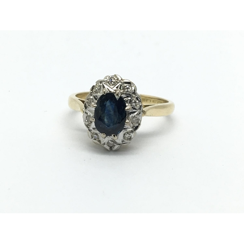 22 - An 18ct gold sapphire and diamond cluster ring, approx 3.4g and approx size J-K....