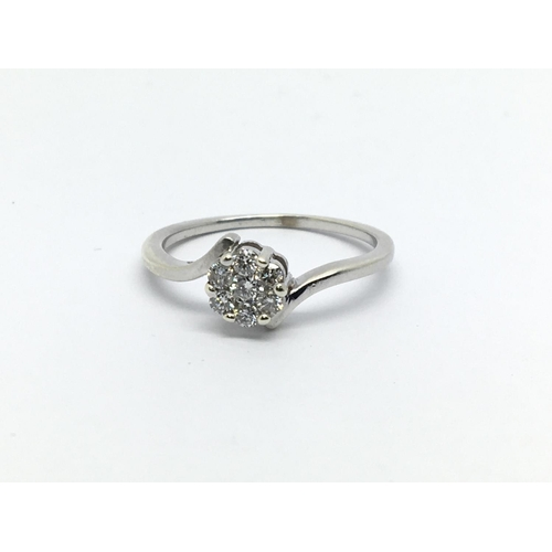23 - An unmarked white gold seven stone diamond ring, approx 1.4g and approx size K....
