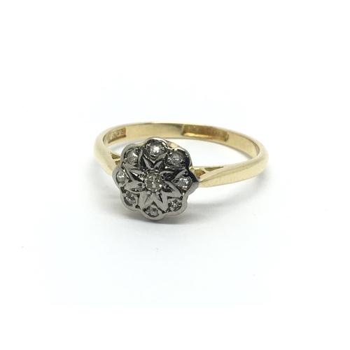 26 - A 1930s 18ct gold ring set with diamonds in the form of a flowerhead, approx 2.7g and approx size P-...