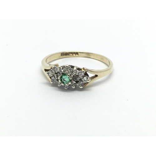 28 - A 9ct gold emerald and diamond cluster ring, approx 1.4g and approx size I....