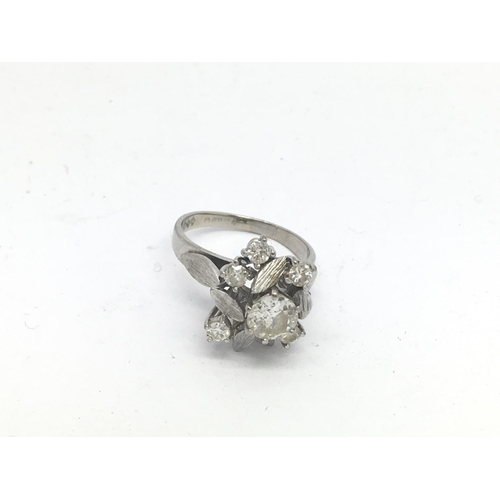 3 - An 18ct white gold floral design diamond cluster ring, centre stone approx 1ct with 5 surrounding st...