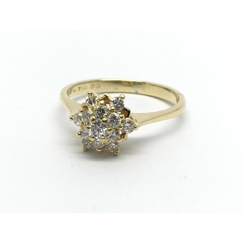 30 - An 18ct gold diamond cluster ring in the form of a flowerhead, approx .33ct, approx 2.5g and approx ...