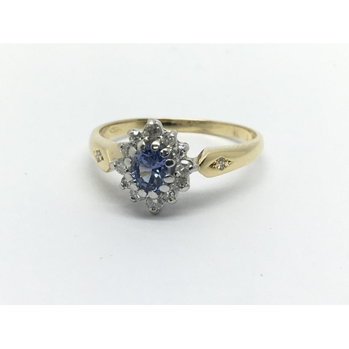 36 - An unmarked gold ring set with a central Ceylon sapphire and surrounded by diamonds, approx 2.4g and...