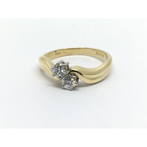 37 - An 18ct gold two stone diamond ring, approx 1/2ct, approx 3.9g and approx size N....