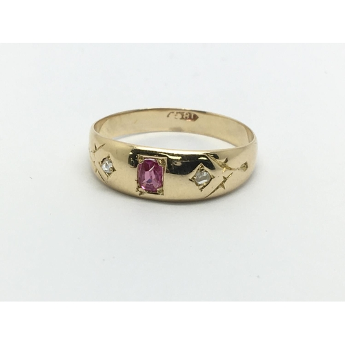 39 - A vintage 18ct gold ruby and two diamond ring, approx 2.3g and approx size N....