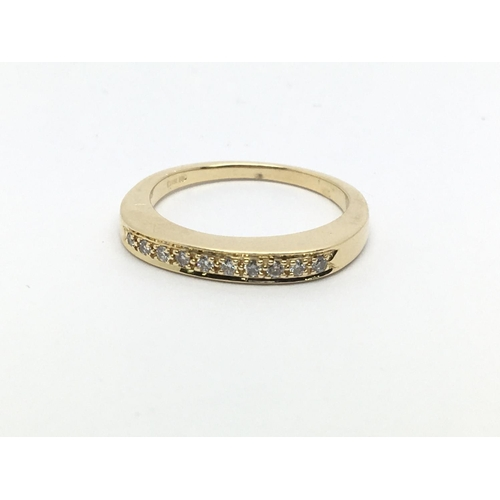 43 - An 18ct gold half eternity ring, approx .12ct, approx 3.3g and approx size K....